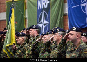 NATO_soldiers-of-the-1st-germannetherlands-corps-salute-during-eefh89