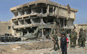 Italian soldiers guard the Carabinieri building which was destroyed Wednesday by a truck bomb, in the Italian compound in al- Nassiriya 350 km south of Baghdad on Thursday, 13 November 2003. A suicide bomber blew up a truck packed with explosives at the Italian military base Wednesday, killing at least 26 people. The United States struck at the Iraqi resistance hours later, destroying a warehouse in Baghdad and chasing attackers who were seen firing mortars. EPA/ALI HAIDER EPA